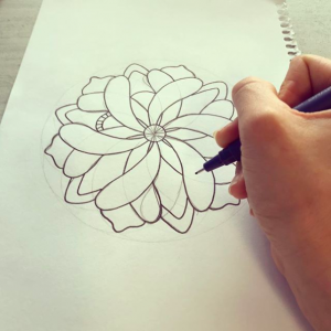 Grace Cuell drawing mandala for the 2nd edition
